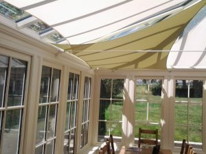 Classic-Oak-frame-garden-room-stretched-shade-sails